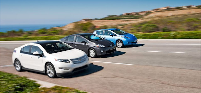 2011-chevrolet-volt-2011-nissan-leaf-2011-toyota-prius-front-end-in-motion