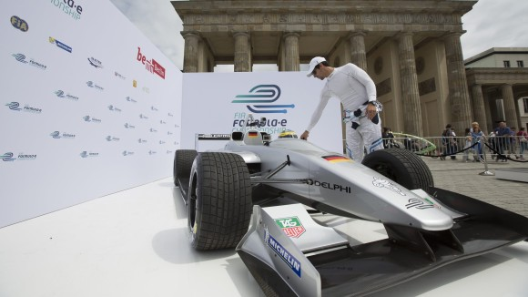 Test-driver-Lucas-di-Grassi-enters-Formula-E-racing-car-during-a-presentation-in-front-of-Brandenburg-Gate-in-Berlin