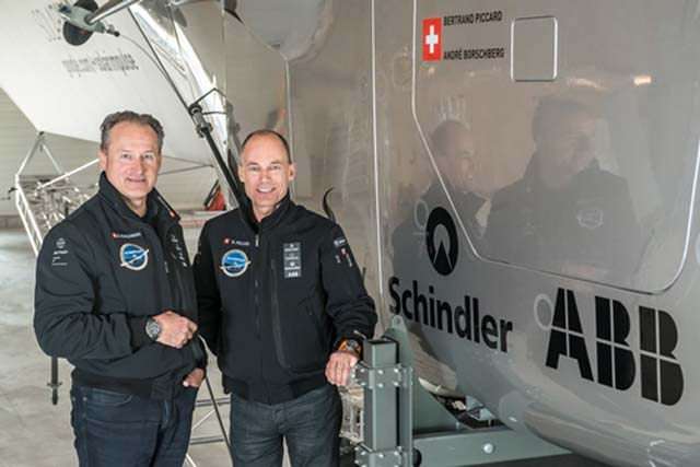 Payerne, Switzerland: (From left to right) André Borschberg, Co-founder and CEO and Bertrand Piccard, Initiator and Chairman are standing beside the cockpit of Solar Impulse 2, the single seater solar airplane with which they will attempt in 2015 the first round-the-world solar flight.