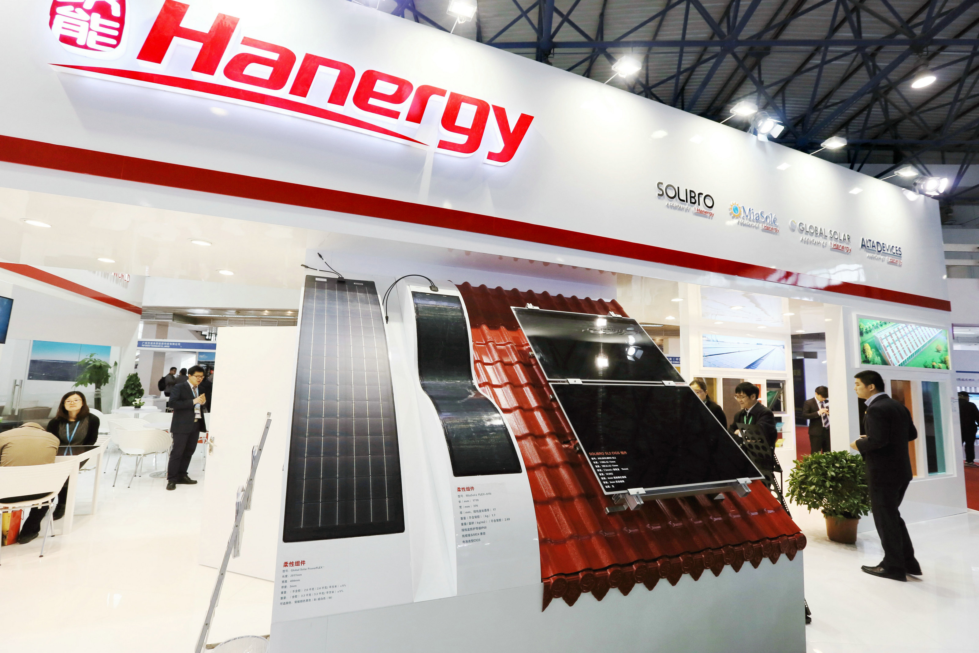 --FILE--People visit the stand of Hanergy during an exhibition in Beijing, China, 1 April 2015. Hanergy Group founder Li Hejun has raised his holding in the company's Hong Kong-listed solar business, signalling confidence in its prospects even after a 180 per cent share price rise this year — and netting a $4.8m paper profit in less than a week. Hong Kong-listed Hanergy Thin Film has come under scrutiny in recent months because of its soaring share price and the high level of sales it makes to its own parent company. Shares in HTF have climbed 350 per cent in six months, making the solar equipment supplier the best performer in Hong Kong's Hang Seng Composite index. But, in the past week, Mr Li has spent HK$264m ($33.9m) buying more HTF shares at between HK$6.9 and HK$6.92, according to regulatory filings with the Hong Kong Stock Exchange. On Thursday (23 April 2015), shares in HTF, which had traded tightly between HK$6.9 and HK$6.93 since April 16, jumped 14.2 per cent to close at HK$7.88, giving Mr Li a $4.8m paper profit on his latest investments in the company. In another filing on Thursday, made at the request of the stock exchange, HTF said it knew of no reason for Thursday's increased price and trading volume, nor of any information that should be disclosed to the market.