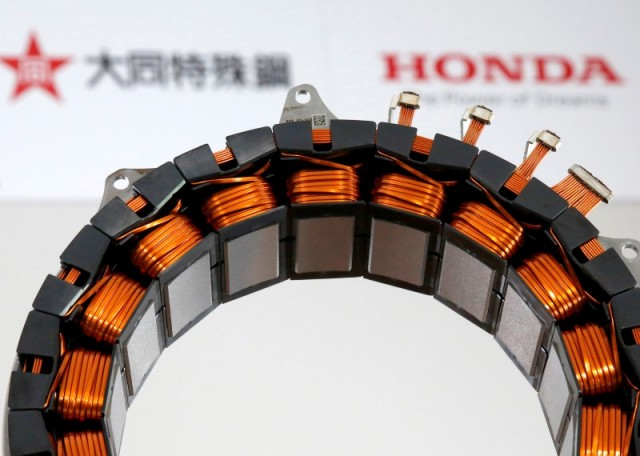 A unit for the the world's first electric motor for hybrid cars that uses no heavy rare earth metals jointly developed by Honda Motor Co. and Daido Steel Co. is displayed at an unveiling in Tokyo