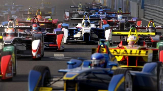 Formula E cars drive into a corner during the Formula E Championship race in Beijing