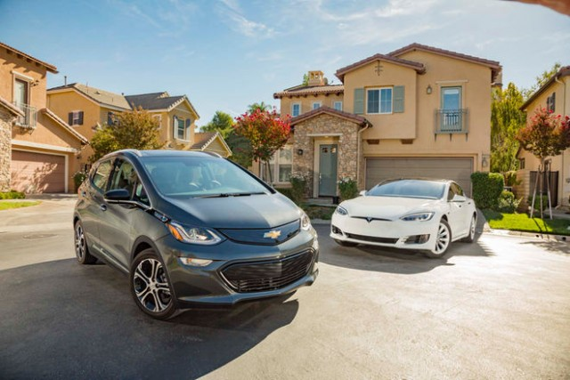2017-chevrolet-bolt-ev-premier-vs-2016-tesla-model-s-60-front-three-quarters