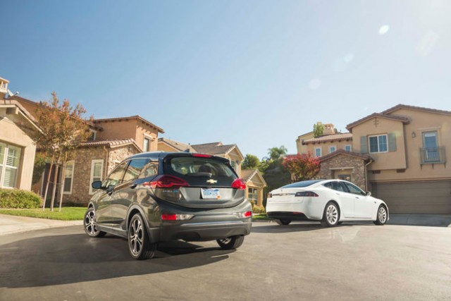 2017-chevrolet-bolt-ev-premier-vs-2016-tesla-model-s-60-rear-three-quarters